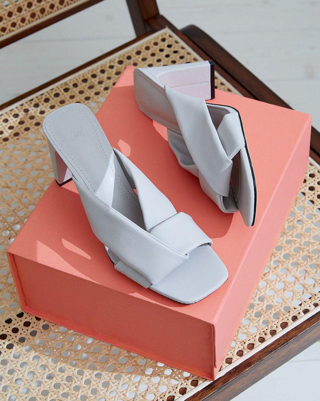 Purple wedge heels on top of an orange box