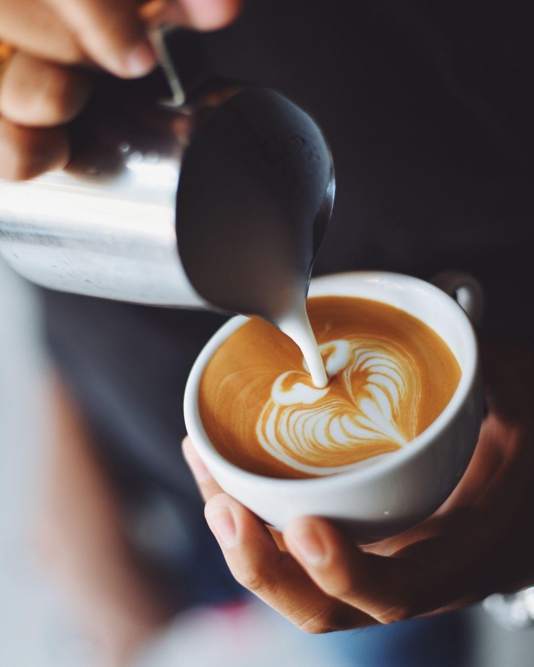 Barista making latte art