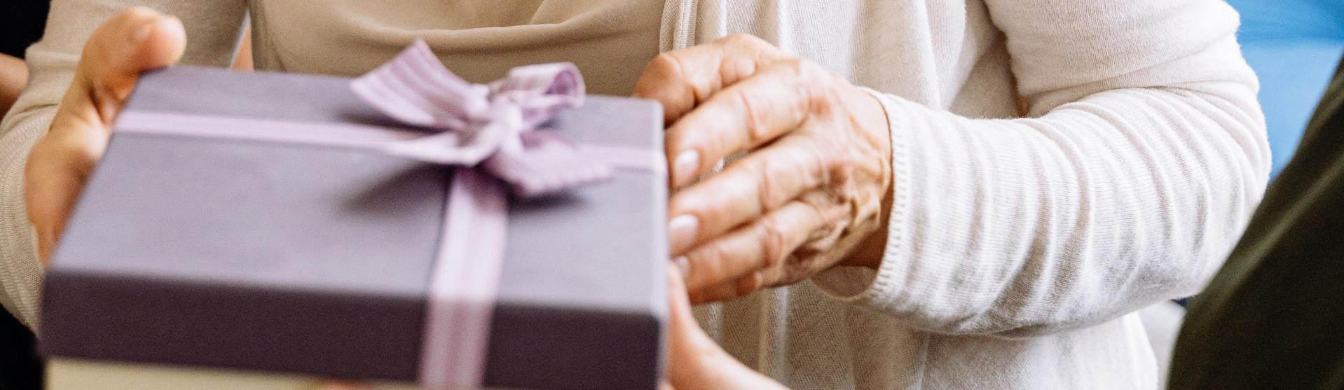 Hand holding a purple gift box