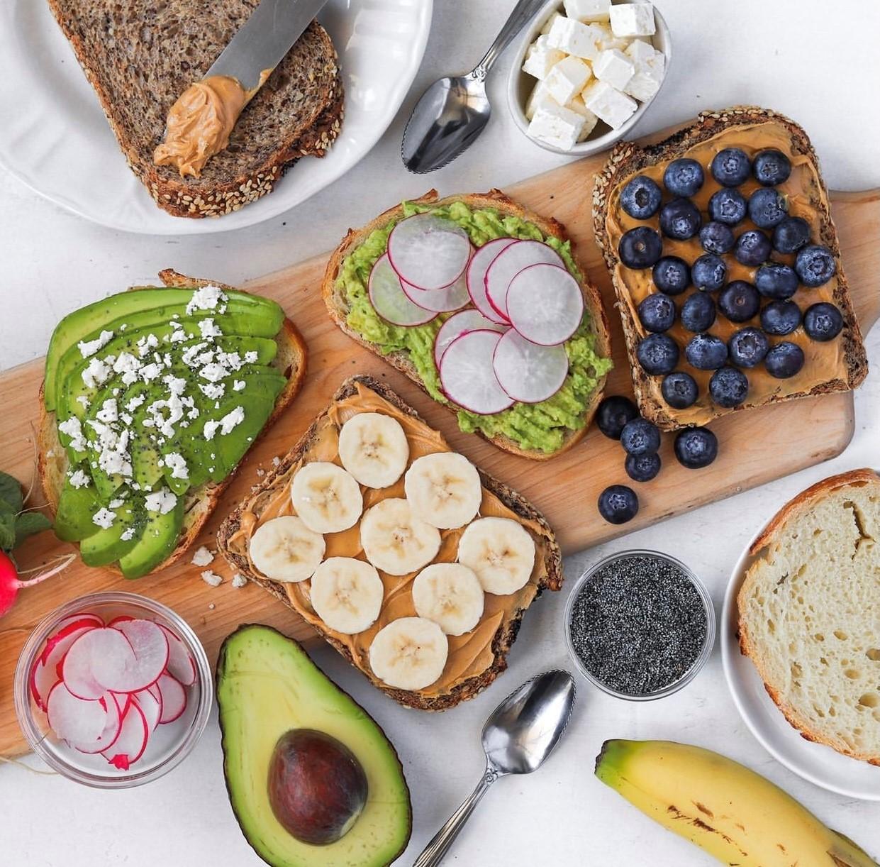 Avocado toast, banana and peanut butter toast, peanut butter and blueberry toast