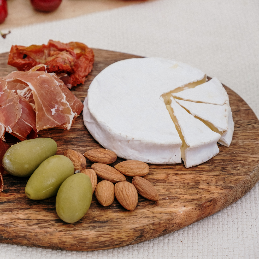 Cheese, charcuterie and nuts on a board