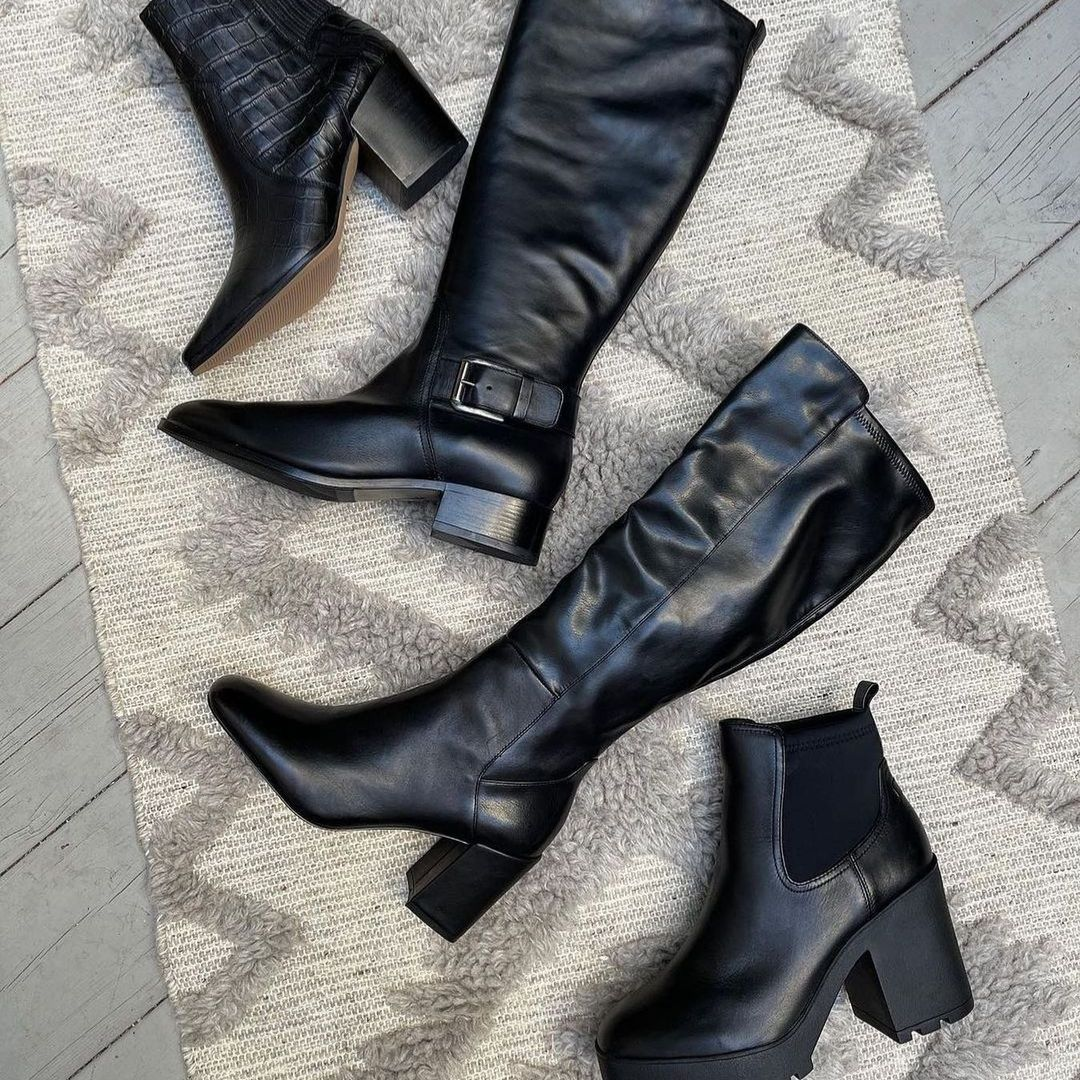 Flatlay of black leather boots