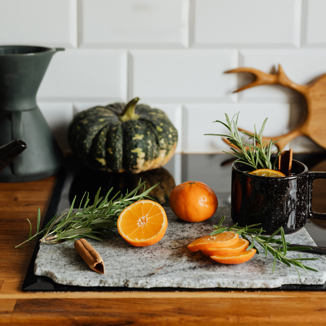 Pumpkins and oranges on a cutting board