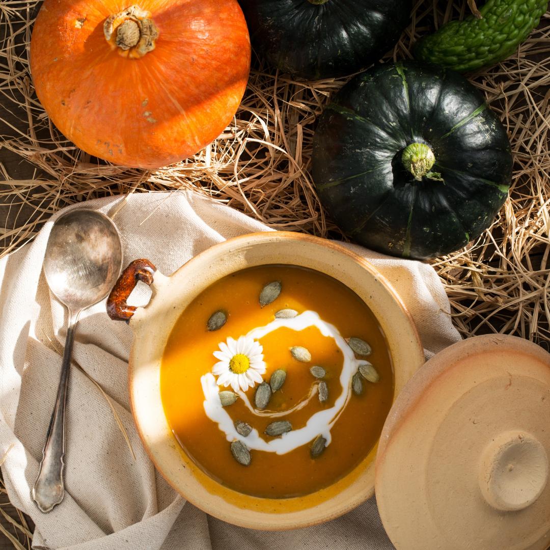 Pumpkin soup surrounded by pumpkins