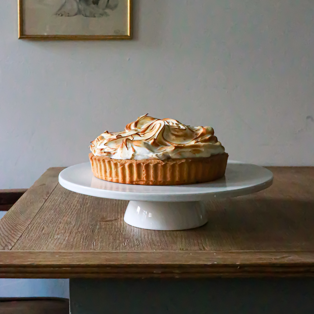A pie on a white cakestand