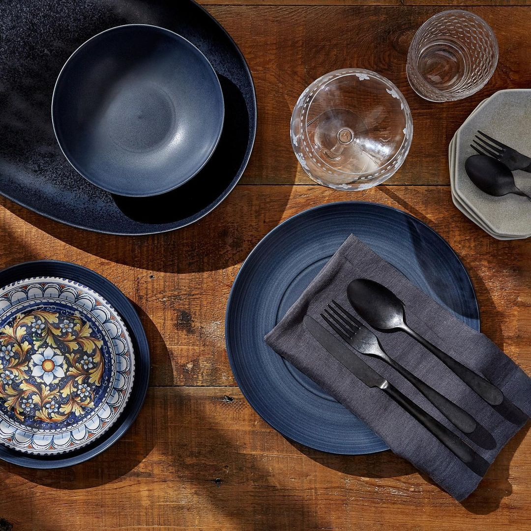 Dark blue tablescape and cutlery