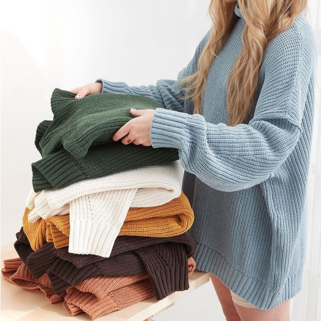Stack of knit sweaters