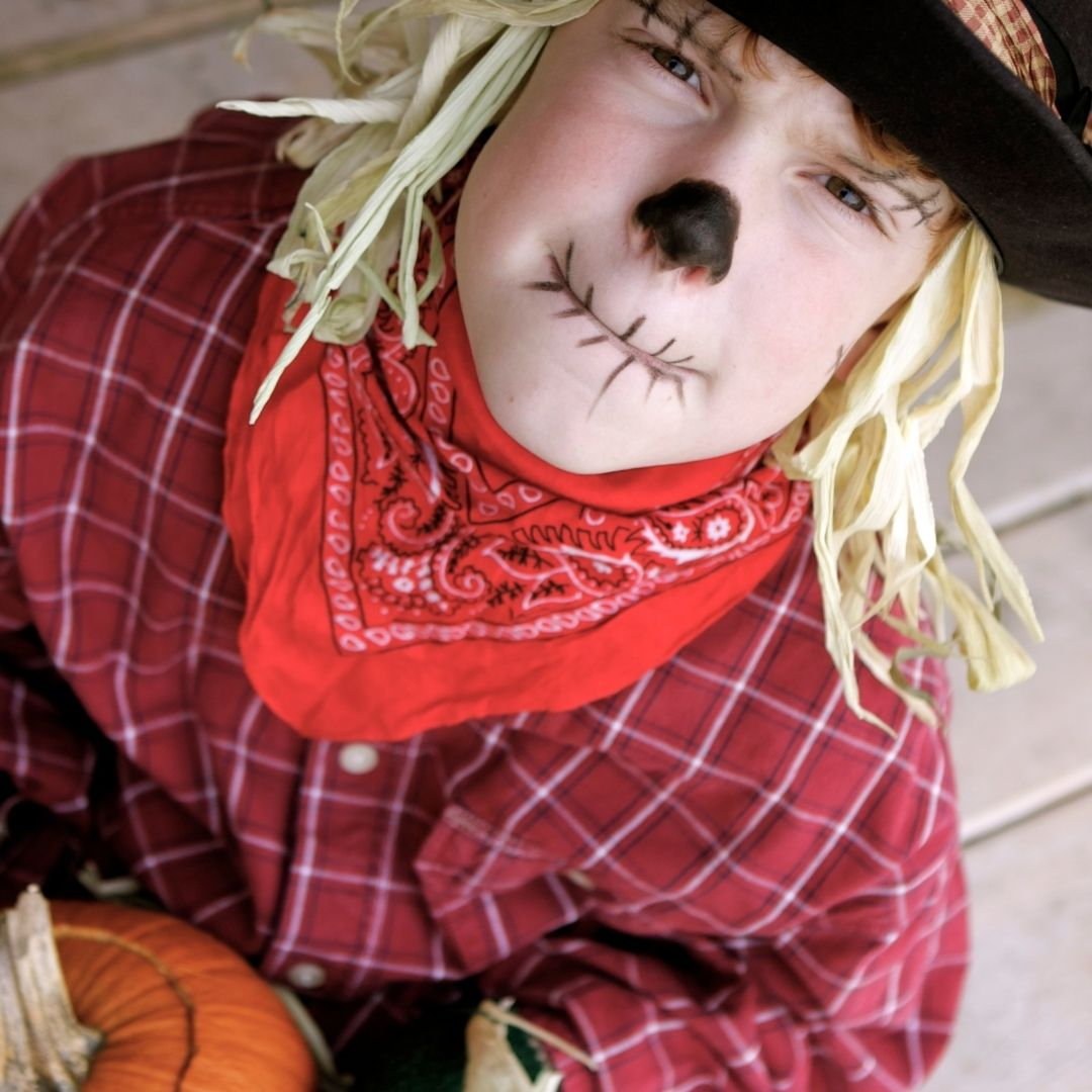 Boy dressed up as a scarecrow