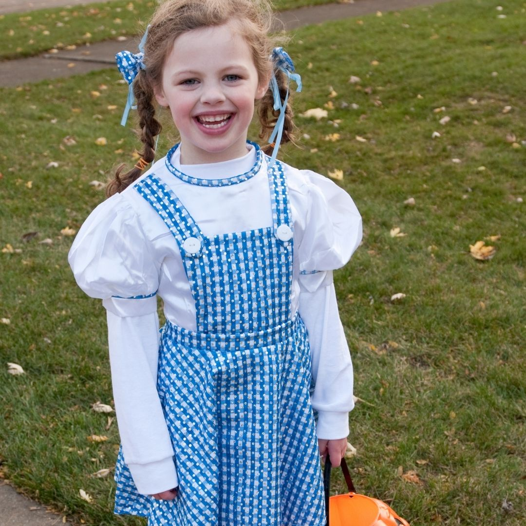 Girl dressed as Dorothy in from Wizard of Oz